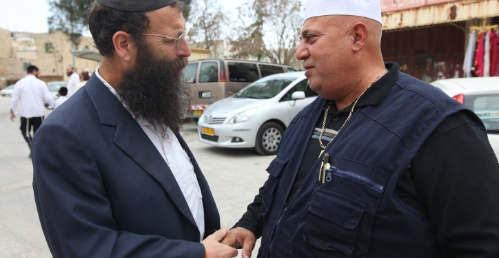 Israeli right-wing activist Baruch Marzel (L) shakes hands with a Palestinian man during a tour of the heads of the Shas, United Torah Judaism, National Union, and Likud parties at the Cave of the Patriarchs, on Sunday, Febuary 21, 2010 as part of a tour conducted by the Land of Israel Lobby, in the West Bank city of Hebron. Photo by Kobi Gideon / FLASH90 *** Local Caption *** ?????? ???? ?????? ????? ???? ???? ???? ???? ??? ????? ???? ???? ????? ???? ????  ???????? ????????? ??????? ???????? ???????? ????????? ??????? ???????? ???????? ????????? ??????? ???????? ???????? ????????? ??????? ???????? ??????? ???????? ??????? ???????? ???????? ????????? ???????? ????????? ???????? ????????? ???????? ??????? ???????? ??????? ????????? ????????