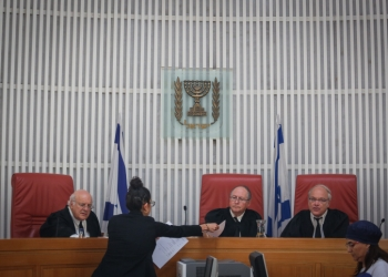"Judges, Eliyakim Rubinstein, Hanan Meltzer, and Nil Hendel, enter the room at the Jerusalem Supreme Court, before hearing the State's answer to Palestinian prisoner, Muhammed Allaan's petition to be released. Allaan, a prisoner held without trial, has been on hunger strike for almost two months and is in critical condition. August 17, 2015. Photo by Hadas Parush/Flash90 *** Local Caption *** ????? ???? ???? ?????? ???? ??????? ???? ??? ???? ??? ????? ?????? ??""? ????? ??? ????? ?????? ??????? ????? ??? ????? ????? ?????? ???? ?????? ?????????? ??? ???? ??? ????"