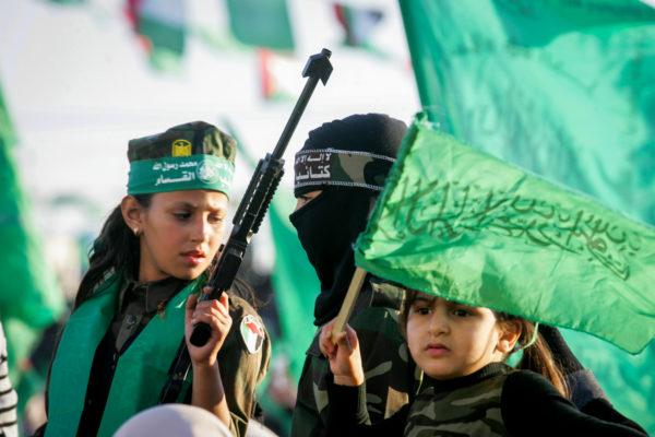 Hamas supporters take part in a rally marking the 29th anniversary of the founding of the movement on December 11, 2016, in Khan Yunis, in the southern Gaza Strip. Photo by Abed Rahim Khatib/Flash90 *** Local Caption *** çîàñ ôìñèéðéí ôìùúéðéí ôìñèéðé òæä çîåùéí