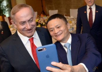 Prime Minister Benjamin Netanyahu takes a selfie picture with chairman of Ali Baba, Jack MK, during a meeting with with chairmen of large corporations in China, during his visit to China, on March 20, 2017. Photo by Haim Zach/GPO *** Local Caption *** ??? ?????? ?????? ???? ????? (???? ???) ?? ??? ????? ???????? ???????? ??????? ????? ????.  ??????? ???? ??? ??? ????? ?? ????? ???????? ??????.  ??? ????????: ???? ??????, ???? ???????, ???? ?????, ???? ?????, ???? ?????. ??? ?????? ?????? ?????? ?????? ?? ???? ??? ???? Alibaba Jack Mk