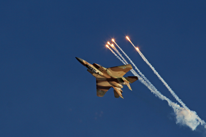 """Aerobatic display of the F-15I fighter jet named as Ra'am, Hebrew for Thunder, during the IAF (Israeli army Air Force) flight course 166 graduation ceremony in the Hatzerim Air Base in the Negev desert, southern Israel, on June 23, 2013. Photo by Ofer Zidon/Flash90 *** Local Caption *** ??? ????  ???-? ????? ??""""?  ????? ???? ??? ??? ???? ???? ????? ???? ???? ??? ?????"""