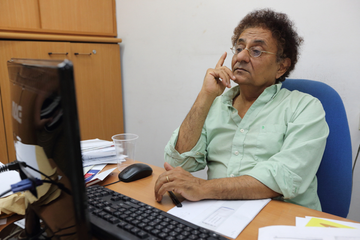"""Yediot Ahronot journalist, Ben Dror Yemini, seen in his office on October 9, 2014. Yemini recently published his new book, """"the Lie Industry."""" Photo by Yaakov Naumi/Flash90.  *** Local Caption *** ??????? '?????? ??????? ?? ???? ????? ?? ???? ???? '?????? ??????'."""