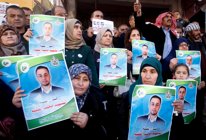 Palestinians hold pictures of their relatives during a protest demanding Israel to return the bodies of Palestinian terrorists, in the village of Doura, south of Hebron, January 6, 2017. Photo by Wisam Hashlamoun/Flash90 *** Local Caption *** ???????? ??????? ????? ????? ?????? ?????? ????? ?????? ?????