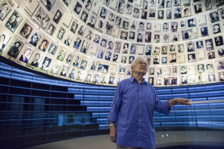 Jewish Holocaust survivor Yehuda Bacon looks up at photographs of Jewish Holocaust victims in the Hall of Names at Yad Vashem, Israel's main Holocaust remembrance and education center in Jerusalem on September 18, 2014. Born in 1929 in Ostrava, Czech Republic, Bacon went through a series of concentration camps from 1942 to 1945, including Auschwitz-Birkenau. He lost his father, mother and sister in the Holocaust. After the war, Bacon became an artist, to process his experiences and to try to describe what he lived through. As a survivor he feels a responsibility to tell his story and to teach to future generations to make them aware of their responsibility in the present and the future. His work is featured in the Yad Vashem Museum. Photo by Yonatan Sindel/Flash90 *** Local Caption *** ????? ???? ?? ??? ???? ????? ???? ????? ????  ????? ????
