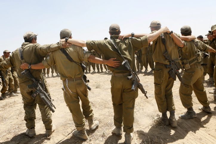 """Israeli soldiers sing as they embrace each other at a staging area in Southern Israel near the border with Gaza, as Israeli forces prepare to clear the area, on August 06, 2014. Operation Protective Edge comes to a close as the Israeli government and the army have declared the mission of destroying Hamas terror tunnels to Israel has been completed. Photo by Miriam Alster/Flash90 *** Local Caption *** ??""""? ????? ??? ?????? ???? ??? ????? ???? ????? ???? ??? ???? ????? ??"""