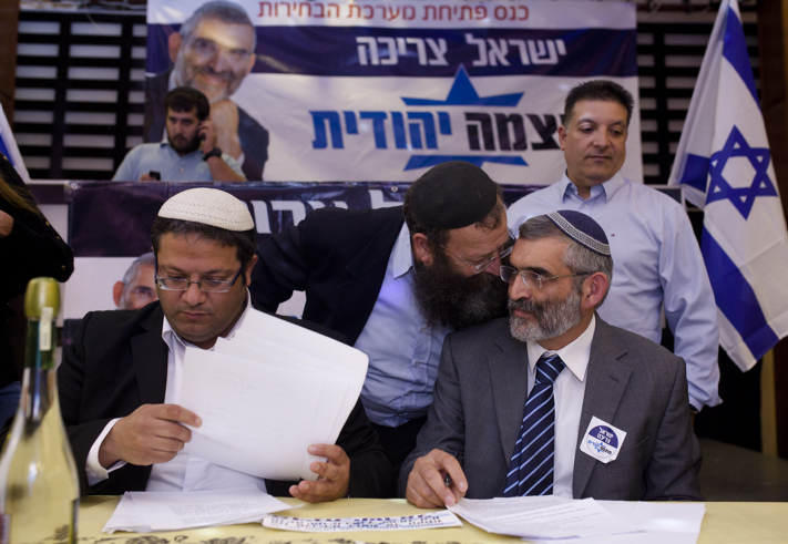 """Former Israeli parliament member and leader of the """"Otzma Yehudit""""  party Michael Ben Ari (R) seen with Itamar Ben Gvir and Baruch Marzel at the party's inaugural election conference in Petach Tikva, on December 24, 2014, where they declared the  """"Right-wing does not talk about a 'two-state solution"""". Israel will hold new government elections on March 17. Photo by Amir Levy/FLASH90 *** Local Caption *** ??? ?????? ????? ??????  ????? ?? ???? ????? ?? ??? ???? ????"""