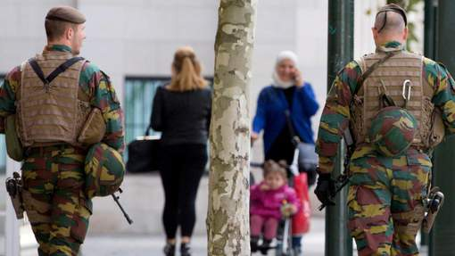 Soldiers from the Belgian Army patrol outside the Palace of Justice in Brussels during a hearing with the lawyers of Mehdi Nemmouche, a suspect in the Brussels Jewish museum attack, on Thursday, Sept. 21, 2017. Mehdi Nemmouche, who is suspected of shooting dead four people at the Jewish Museum in Brussels on May 24, 2014, has complained to his lawyers that his health in custody is deteriorating. (AP Photo/Virginia Mayo)
