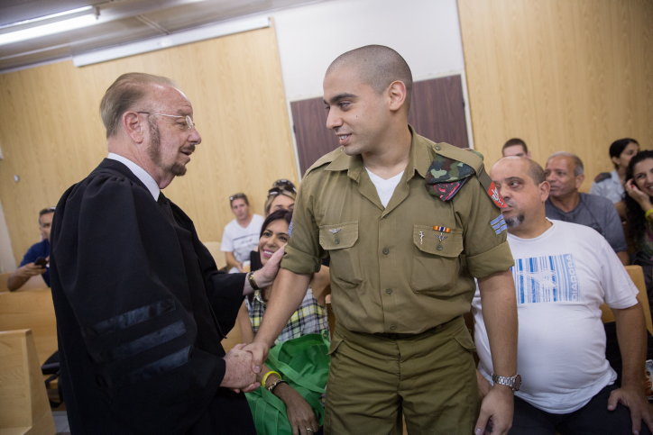IDF Sgt. Elor Azaria, the Israeli soldier, who shot dead a disarmed and injured Palestinian attacker in the West Bank city of Hebron on March 24, 2016, shake hands with his attorney Yoram Sheftel before the start of a court hearing at the Kirya military base in Tel Aviv, on July 17, 2017. Photo by Miriam Alster/Flash90 *** Local Caption *** ???? ????? ?????? ????? ???? ????? ???? ???? ????? ???? ??? ???? ????? ????? ????? ????? ????? ???? ????