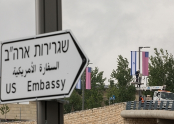 """Jerusalem municipality worker hangs an American and Israeli flags near the US consulate in Jerusalem on May 7, 2018. Photo by Yonatan Sindel/Flash90 *** Local Caption *** ??? ????? ????? ????  ???""""? ???? ???? ???????"""