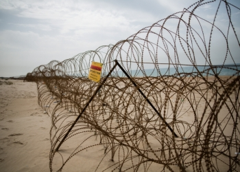 A barbed wire fence is seen on Zikim beach, in southern Israel near the border with Northern Gaza Strip, on April 5, 2016. Photo by Corinna Kern/Flash90 *** Local Caption *** ????? ???? ??? ????? ??? ???? ????? ???  ?? ??? ???