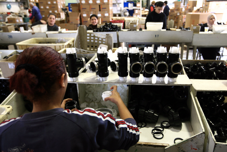 Plassim factory in Kibbutz Merchavia, Emek Israel. Palestinian worker putting together hose attachments. Feb 25, 2008  Photo by Nati Shohat/Flash90   *** Local Caption *** ??? ????? ????? ?????? ???? ????? ????? ?????? ????? ??? ????? ??? ?????? ???? ??????? ???????? ??????? ???????? ???????? ????????? ???????? ????????? ???????? ????????? ???????? ??????? ???????? ??????? ????????? ????????