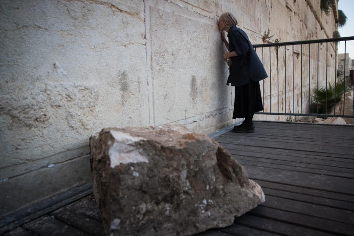 Daniela Goldberg stands at the site where a large chunk of stone dislodged from the Western Wall in Jerusalem Old City, at the mixed-gender prayer section on July 23, 2016. Photo by Yonatan Sindel/Flash90 *** Local Caption *** ???? ?????? ???? ????? ????? ???? ??? ???????? ??? ???? ????????? ?? ????? ???? ???? ????? ????? ?????? ???? ?????? ??????? ???? ????? ??? ???