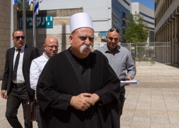 Druze men protest outside the Hafia District Court during a trial against a Druze man, on April 23, 2018. The Druze man is charged with invovlement in incident where a group of men tried to prevent the evacuation of wounded Syrians in the northern town of Hurfeish in 2015. Photo by Flash90 *** Local Caption *** ?????? ??????? ?????? ? ??? ????? ? ???? ??? ???? ??????? ? ????  ?????? ?? ?? ???? ??????? ????? ?????? ?????? ? ??????? ???? ?????? ???? ????? ?????  ?????? ????? ????????
