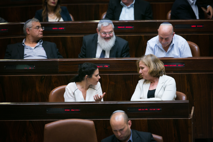 Newly appointed minister of Justice Ayelet Shaked (L) speaks with former minister of Justice Tzipi Livni  during a plenum session and  vote on expanding the number of ministers in the new forming government, a law which now passed on the first call, at the plenary in the Knesset on May 11, 2015. Photo by Miriam Alster/Flash90 *** Local Caption *** ????? ????? ?????? ???? ????? ????? ????? ????? ???? ??? ??????? ????? ??? ???? ?????? ???? ????? ????