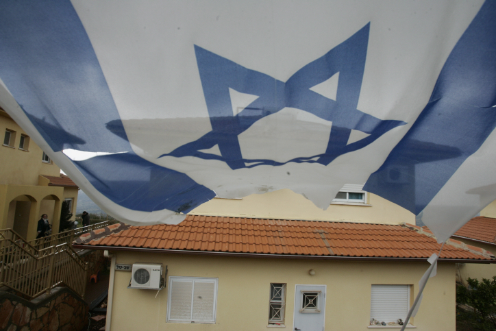 An Israeli flag hangs near a house in Bruchin; a young Jewish town located on the hills of Shomron. March 03, 2009. Photo by Uri Lenz/Flash90 *** Local Caption *** ?????? ??? ??