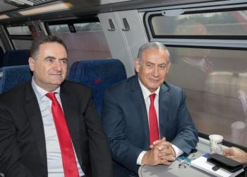 Israeli Prime Minister Benjamin Netanyahu (R) and Minister of Transportation Israel Katz (L) during a test drive of the Jerusalem-Tel Aviv express train in central Israel on September 20, 2018. Photo by Noam Revkin Fenton/Flash90 *** Local Caption *** ????? ?? ???? ????? ?? ???? ??????? ??? ?????? ?????? ?????? ????