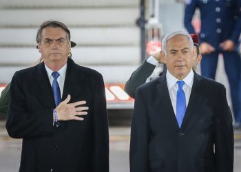 Brazilian president Jair Bolsonaro with Israeli Prime Minister Benjamin Netanyahu and his wife Sara, during a welcome ceremony at Ben Gurion Airport near Tel Aviv on March 31, 2019, for his first official visit to Israel since becoming president. Photo by Noam Revkin Fenton/Flash90 *** Local Caption *** ????? ???? ??? ?????? ?????? ?????? ?????