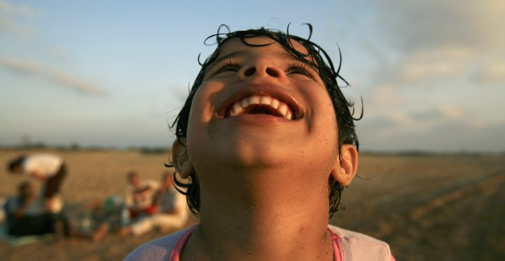 An Israeli child plays at Atlit beach, north of Atlit citadel. June 21 2007. Photo by Doron Horowitz/Flash90 *** Local Caption *** ?? ????? ?????  ??? ????? ????? ??? ???? ???? ????