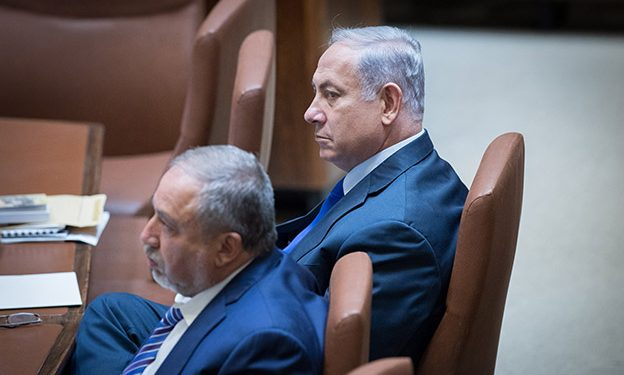 Prime Minister Benjamin Netanyahu and Defense Minister Acigdor Liberman attend a special Plenary memorial for the late, former minister, Rehavam Ze'evi Gandi, at the Knesset, on October 24, 2017. Photo by Yonatan Sindel/Flash90