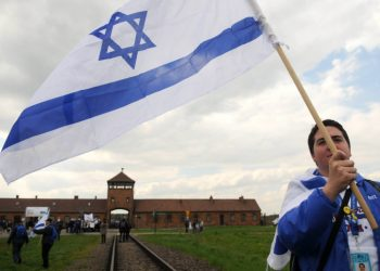 """An Israeli young woman waves the Israeli flag as she participates with hundreds of other Israeli youth  in """"the March of the Living"""" tour which involves visiting concentration and death camps in Poland. May 02, 2011. Photo by Yossi Zeliger/FLASH90  **MAARIV, NRG & AGENICES OUT**  *** Local Caption *** ???? ?????   ??????? ??????? ??? ?????? ????? ????"""