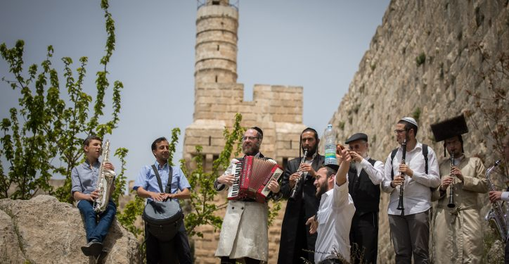 Jewish men play klezmer music as they walk next to the walls of the Jerusalem's Old City, during the Passover holiday, on April 25, 2019. Photo by Yonatan Sindel/Flash90 *** Local Caption *** ????????, ???????, ??? ?????? ????? ????  ?????? ???????? ?? ?? ??? ?????? ????? ???? ???? ?????? ???? ??? ???? ??? ??? ???? ??? ???? ???? ??? ????? ???? ??????. ??????? ????????? ?????? ???? ???????