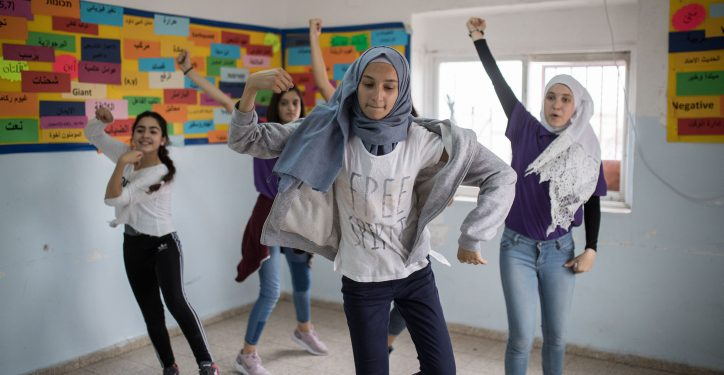 Young female students at a dancing lesson with Israeli teacher Neria Cohen, at the Arab private school, Promise, in Beit Hanina, East Jerusalem, on May 6, 2018. Neria is a religious Jew who teaches young Arab students dancing lessons. Photo by Hadas Parush/Flash90 *** Local Caption *** ??? ????? ????? ?????? ???? ??? ?????? ???? ?????, ??????? ???? ???