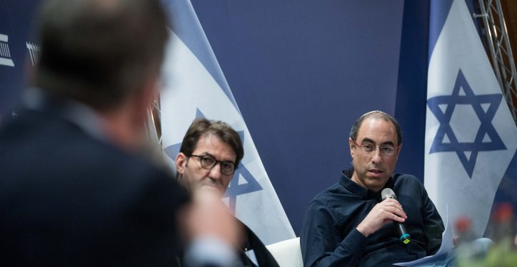 """Israeli journalist Kalman Liebskind (R) attends a conference organized by """"Makor Rishon"""" and the Israeli Democracy Institute at the International Convention Center in Jerusalem, March 11, 2018. Photo by Yonatan Sindel/Flash90 *** Local Caption *** ??? ???? ????? ???? ????????"""