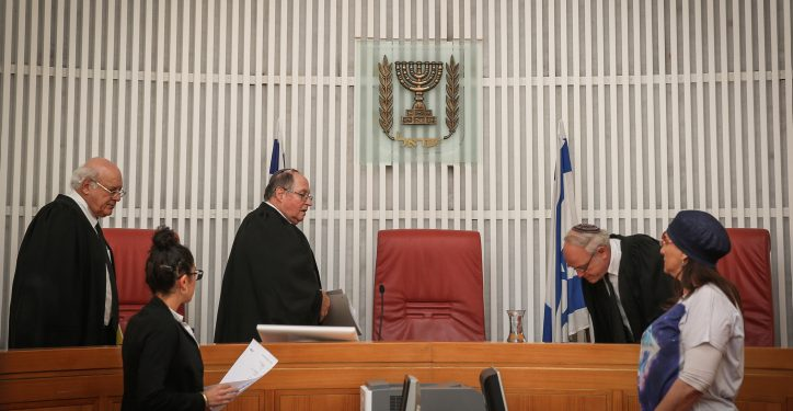 """Judges, Eliyakim Rubinstein, Hanan Meltzer, and Nil Hendel, enter the room at the Jerusalem Supreme Court, before hearing the State's answer to Palestinian prisoner, Muhammed Allaan's petition to be released. Allaan, a prisoner held without trial, has been on hunger strike for almost two months and is in critical condition. August 17, 2015. Photo by Hadas Parush/Flash90 *** Local Caption *** ????? ???? ???? ?????? ???? ??????? ???? ??? ???? ??? ????? ?????? ??""""? ????? ??? ????? ?????? ??????? ????? ??? ????? ????? ?????? ???? ?????? ?????????? ??? ???? ??? ????"""