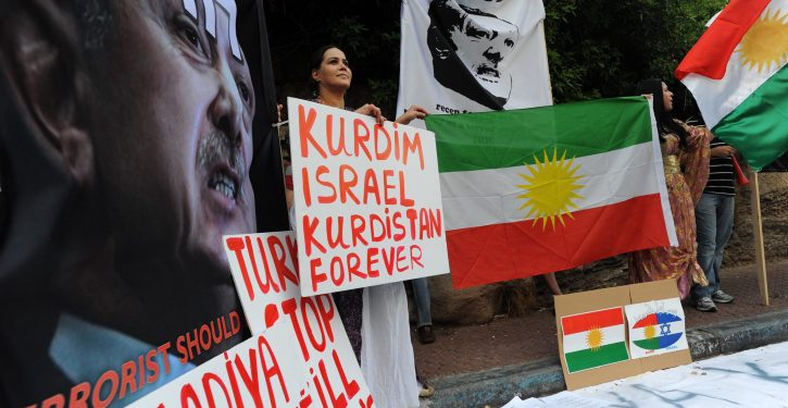 Israelis hold up placards, including a portrait of Turkey's Prime Minister Recep Tayyip Erdogan' labeled wanted, during an anti-Turkish protest outside the Turkish embassy in Tel Aviv on July 08, 2010. Protesters waved Kurd flags and chanted slogans in favor of the Kurd people and against, what they call, their depression by Turkey. Photo by Gili Yaari / Flash 90. *** Local Caption *** ???? ?????? ????? ??? ??????? ?????? ?????? ??? ????? ?????? ??? ????? ??? ?????? ??? ??????