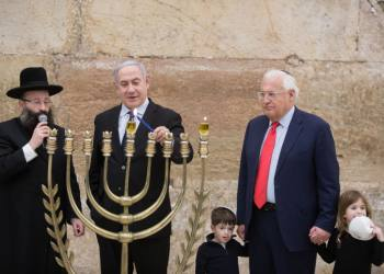 Israeli Prime Minister Benjamin Netanyahu lights the 'Chanuckia' on the First night of the Jewish holiday of Hanukkah at the Western Wall in Jerusalem Old City on December 22, 2019, together with Israeli soldiers and US ambassador to Israel, David Friedman. Photo by Noam Revkin Fenton/Flash90 *** Local Caption *** ??? ?????? ?????? ?????? ???? ????? ???? ???? ????? ???? ????? ??????