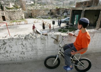 Young Jewish kid sits on his bicycle and looks on in the street of the Jewish neighborhood in the Old City of the West Bank city of Hebron on Monday, Apr 20, 2009. Photo by Kobi Gideon / FLASH90. *** Local Caption *** ????? ???? ????? ??? ????? ??????? ???? ???? ???????