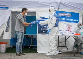 People arrive to vote at a special polling station for voters quarantined due to possible exposure to the new coronavirus in Jerusalem, during the Knesset Elections, on March 2, 2020. Photo by Nati Shohat/Flash90 *** Local Caption *** ????? ?????? ???? ??? ??????? ?????? ?????? ????? ?