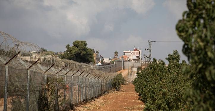 """The border fence between Israel and Lebanon, once known as the """"Good Fence"""" seen through an apple tree field outside the Northern Israeli town of Metula, on November 19, 2017. Photo by Hadas Parush/Flash90 *** Local Caption *** ????? ???? ???? ???? ????? ????? ???? ????? ????"""