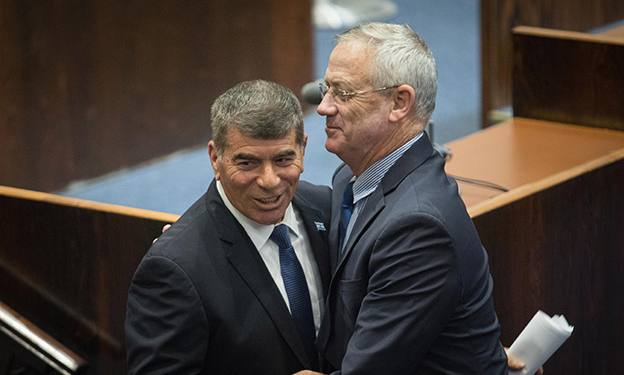 Blue and White party member Gabi Ashkenazi is greeted by party chairman Benny Gantz at the Plenary Hall at the Knesset, Israel's Parliament, in Jerusalem, on May 14, 2019. Photo by Hadas Parush/Flash90