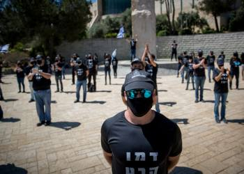 Israelis dressed in black protest against government corruption and for democracy, outside the Supreme Court in Jerusalem on April 30, 2020. Photo by Yonatan Sindel/Flash90 *** Local Caption *** ????? ??? ?????? ?????? ?????? ????? ???? ?????? ??????? ??? ???? ?????