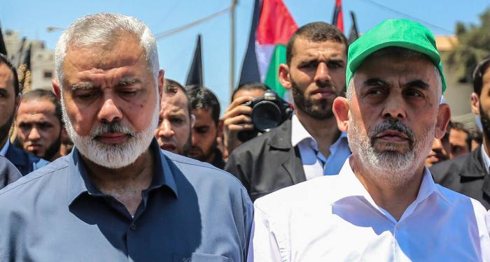 """Hamas leaders in the Gaza Strip Ismail Haniya and Yahya Sinwar march during a protest against US President Donald Trump's """"deal of the century"""" plan and the """"Peace to Prosperity"""" conference in Bahrain, in Gaza City on June 26, 2019. Photo by Hassan Jedi/Flash90 *** Local Caption *** ??????? ???????? ????? ??????? ????? ??? ???? ?????? ??? ??????  ???? ???? ??????? ??????? ?????"""