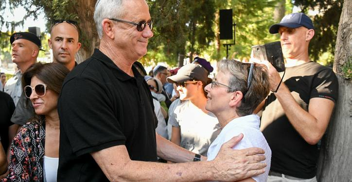 Lea Goldin, mother of Lt. Hadar Goldin with Benny Gantz, head of Blue and White party at a memorial ceremony marking five years to Hadar death and abduction at the military cemetery in Kfar Saba on August 6, 2019. Photo by Flash90 *** Local Caption *** ??? ?????? ?? ???? ???? ??????? ??? ??? ??? ? ???? ??? ????? ????? ??? ???? ??? ????