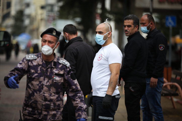 Palestinian municipal workers disinfect the parking lot of a hospital, in the West Bank city of Ramallah, March 12, 2020. Photo by Flash90 *** Local Caption *** ????? ?????? ???? ??? ?????? ??? ????? ???? ?????