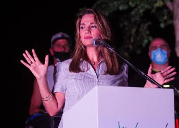 Likud MK Yifat Shasha-Biton speaks during a protest in her support, outside her home in Zichron Yaakov, on August 2, 2020. Photo by Flash90 *** Local Caption *** הפגנה קורונה ועדה בית תמיכה יפעת שאשא ביטון נשים בעד חיזוק