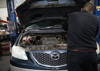 Mechanics work on vehicles at a car garage in northern Israel, on December 8, 2019. Photo by David Cohen/Flash90 *** Local Caption *** ???? ?????? ????? ??? ????? ???? ?????? ???? ?????? ??????????