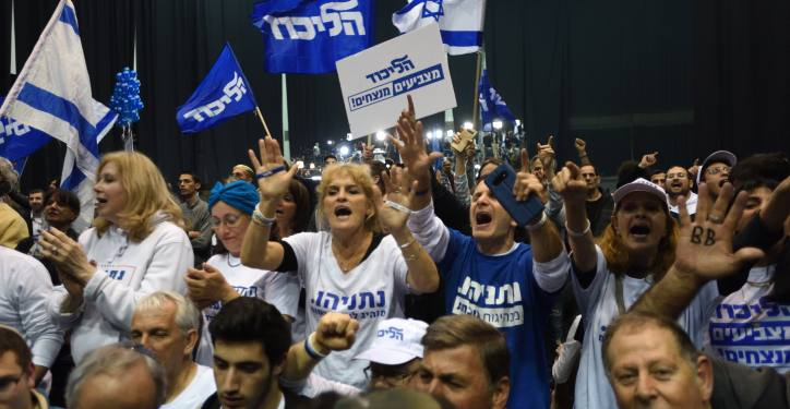 Supporters of Israeli Prime Minister Benjamin Netanyahu celebrate after the release of exit polls results of the Israeli general election, at the party headquarters in Tel Aviv, on March 2'nd, 2020. Photo by Gili Yaari /Flash90 *** Local Caption *** ?????? ?????? ??? ?????? ?????? ????? ?????? 2020 ???? ?????? ????? ?????? ???? ??????