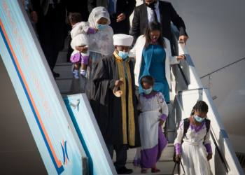 """Members of the Falashmura community arrive at  Ben Gurion airport, outside Tel Aviv, on December 3, 2020. Photo by Miriam Alster/Flash90 *** Local Caption *** ???? ??? ????? ????? ??????? ???????? ??? ????? ?????  ?????  ????????  ???""""?"""