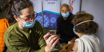 People receives a Covid-19 vaccine, at Clalit Covid-19 vaccination center in Jerusalem, on December 29, 2020.  Photo by Olivier Fitoussi/Flash90 *** Local Caption ***  ??? ???? ??????? ???? ?????? ????? ????? ?????? ???????