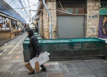 People at the Mahane Yehuda market in Jerusalem on January 3, 2021, during the 3rd lockdown due to the COVID-19 coronavirus pandemic. Photo by Yonatan Sindel/Flash90 *** Local Caption *** ?????? ????? ?????? ???? ???? ??? ???? ?????? ????? ??? ???? ????? ????? ???