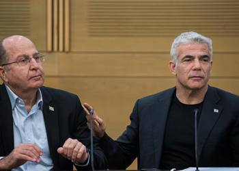 Blue and White party co-chairman Yair Lapid with MK Moshe Yaalon at a faction meeting at the Knesset, the Israeli parliament in Jerusalem, on June 24, 2019. Photo by Yonatan Sindel/Flash90