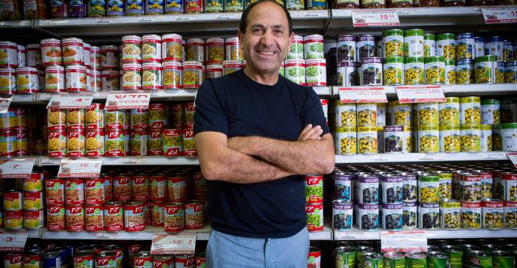 Portrait of Rami Levi in his supermarket in Jerusalem. Levy operates a chain of 27 discount supermarkets in Central and Northern Israel employing over 5,000. It also distributes wholesale to 450 stores in and around Jerusalem. The company has diversified into retail clothing sales, real estate, and cellular communications, with 20 stores of Rami Levy Communications selling cellular phone services at a discount. June 23, 2016. Photo by Miriam Alster / FLASH90. *** Local Caption *** ??? ??? ????? ????? ???? ??????