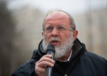 """Rabbi Eli Sadan speaks during a protest in front of the Prime Minister's Office in Jerusalem on February 21, 2016, hundreds of Israelis demonstrate Sunday morning demanding to close Palestinian media networks who shifting against the state of Israel. Photo by Yonatan Sindel/Flash90 *** Local Caption *** ????? ??? ??? ?? ???? ??? ?????? ????? ????? ?????? ????????? ?????? ????? ??""""?"""