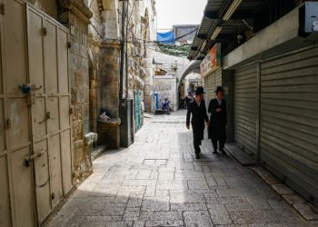 ultra orthodox jewish men walk past closed shops in Jerusalem's Old City, due to a general strike in response to Israel's Nation State Law on October 1, 2018. Photo by Sliman Khader/Flash90 *** Local Caption *** ???????? ????? ???? ?????? ?????? ?????? ???????? ????????? ???????? ??????? ????? ???????? ??????? ????????? ???????? ??? ????? ??? ????? ????? ?????
