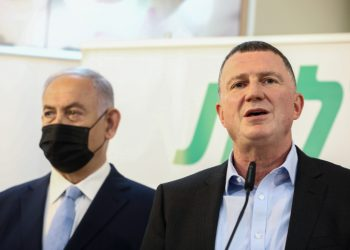 Israeli Prime Minister Benjamin Netanyahu and Health Minister Yuli Edelstein seen during a visit at Covid-19 vaccination center in Zarzir, northern Israel, February 9, 2021. Photo by David Cohen/Flash90 *** Local Caption *** ??? ?????? ?????? ??????   ??????? ?????? ????? ?? ??????? ???? ???????? ????? ?????
