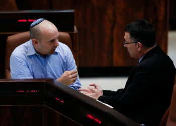 Minister of Internal Affairs Giden Saar (R) and Minister of Economics Naftali Bennett seen during an assembly session in the plenum hall at the Knesset (Israeli parliament) on February 24, 2014. Photo by Miriam Alster/Flash90 *** Local Caption *** ????? ????? ????? ???? ??? ????? ???